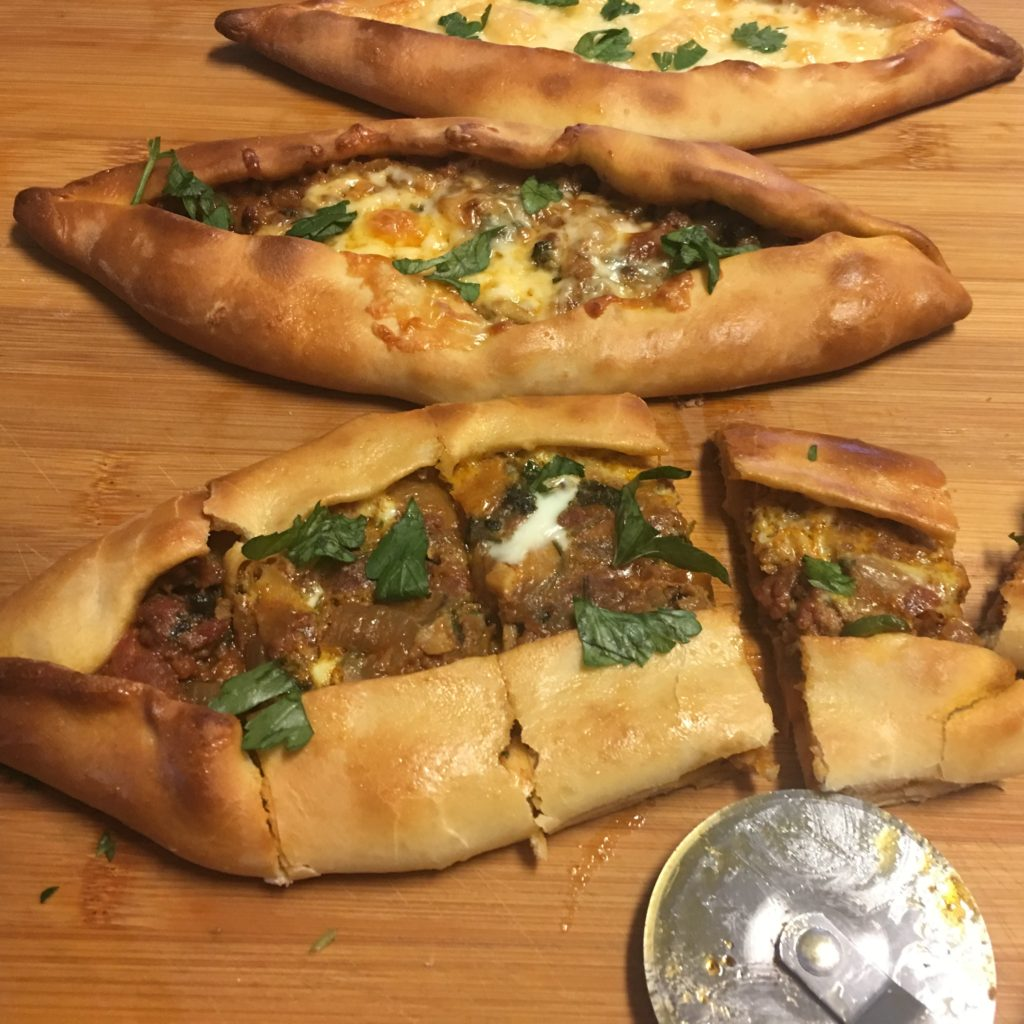 6c7c3ef77f58bd Pide is a Turkish flat bread topped with a variety of toppings such as  ground meat and vegetables